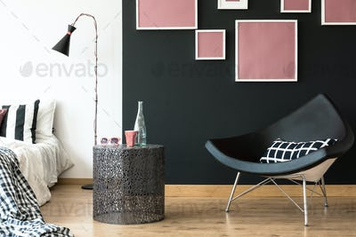 Black triangle shaped chair