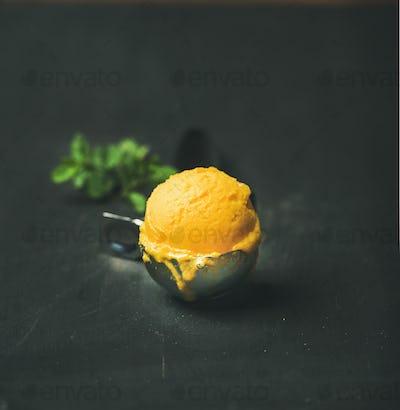 Mango sorbet ice cream scoop, square crop, copy space