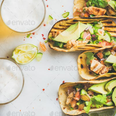 Healthy corn tortillas with chicken, vegetables, limes, square crop