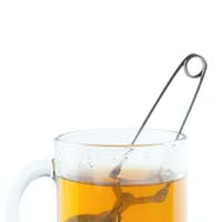 tea strainer in cup
