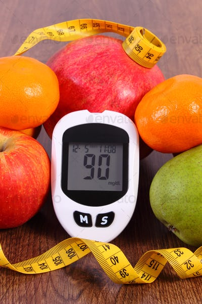 Glucometer with centimeter and fresh fruits, concept of diabetes and healthy nutrition