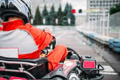 Karting racer, go kart driver in helmet, back view
