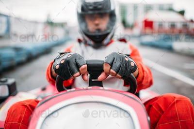 Karting race, go cart driver in helmet