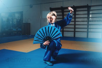 Female wushu master with fan, martial arts