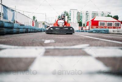 Karting racer on finish line, go kart competition