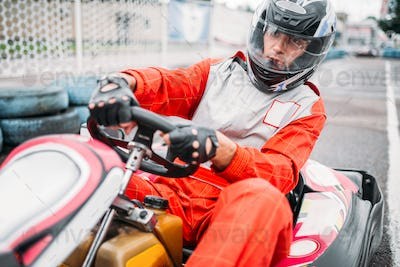 Karting race, go cart driver in helmet