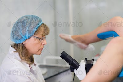 Young Female Gynecologist During Examination In Her Office