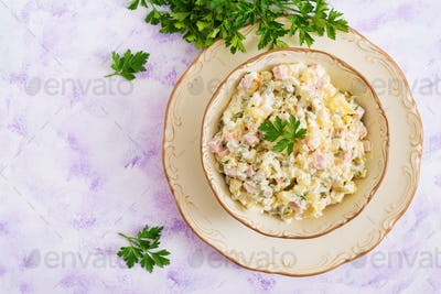"Traditional Russian salad ""Olivier"". New Year salad. Festive salad. Top view"