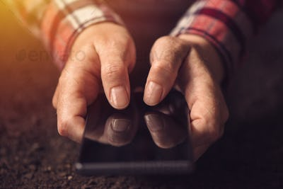 Close up of hands using mobile phone