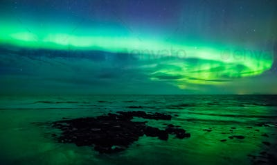 Aurora borealis over the sea, Gardur, Iceland