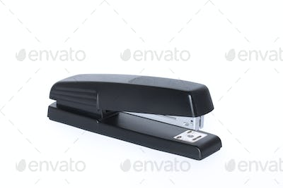Black office stapler isolated on white background