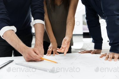 Group of businesspeople working at a table in the office