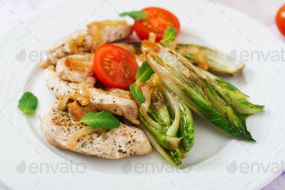 Baked chicory with chicken, onions and herbs.