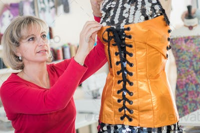 woman seamstress at work in the home