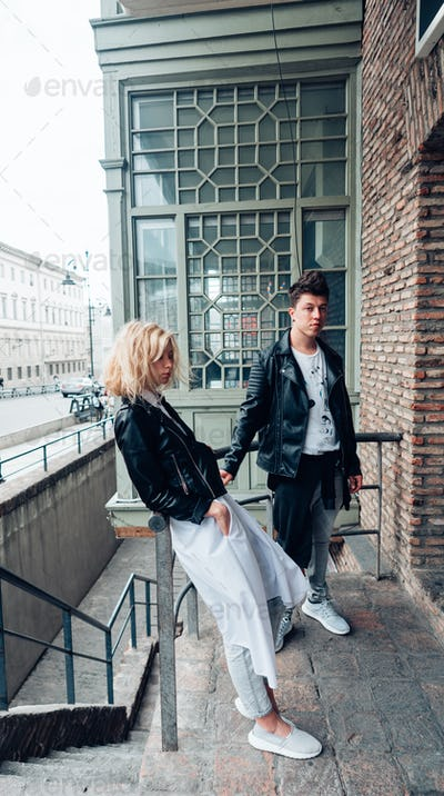 Guy and girl in black jackets on a city street