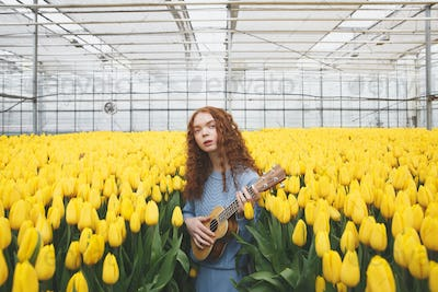 Girl with guitar looking camera
