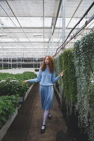 Girl walking in orangery