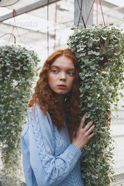 Girl touching plants