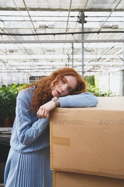 Cute girl lying on boxes