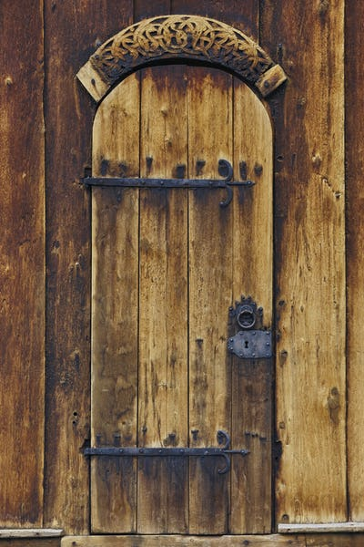 Lom medieval stave church door detail. Viking symbol. Norway tourism