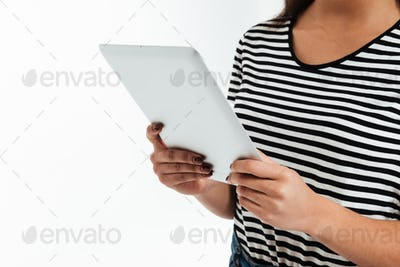 Cropped picture of young african woman using tablet computer.