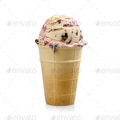 Ice cream with blueberries and chocolate in wafer cup on white background