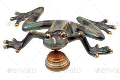 ceramic frog and coins