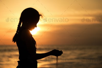 Portrait of sad teenager girl standing on the beach
