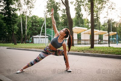 Sporty woman doing fitness exercises in park