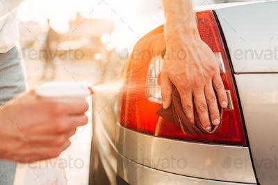 Tail lights polishing on car wash station