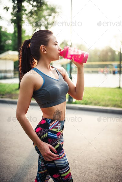 Woman drink water from sport bottle