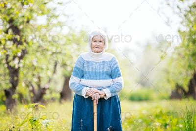 Senior woman on a walk in the orchard