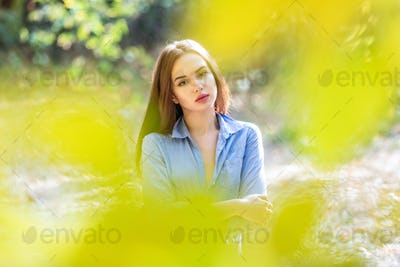 Portrait of a beautiful young woman outdoors