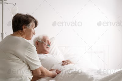 Senior woman supporting sick husband