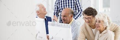 Seniors enjoying computer activities