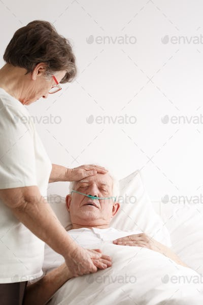 Senior woman supporting her sick husband