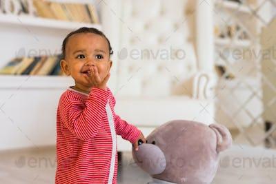 african american baby boy with teddy bear
