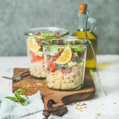 Healthy vegan salad with quionoa, avocado, dried tomatoes, square crop