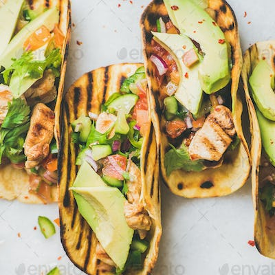 Gluten-free healthy corn tortillas with grilled chicken fillet, avocado, lime