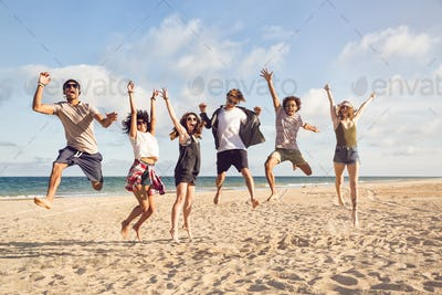 Portrait of excited young friends jumping