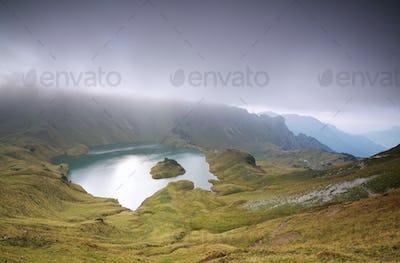 clouds over alpine lake