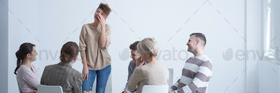 Woman crying during group therapy