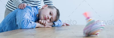 Boy observing spinning top