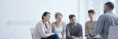 Man confiding problems in support group