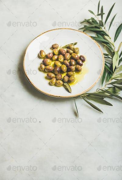 Pickled green Mediterranean olives in virgin olive oil, copy space