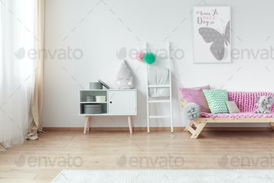 Decorative pillow on cupboard