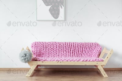 Pink wooden couch