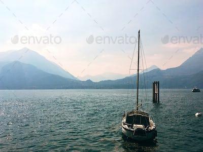 Yacht Anchored at Shore of Lake