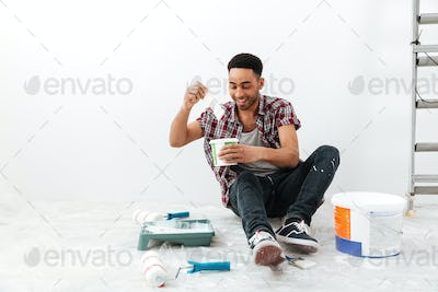 Portrait of sitting man isolated