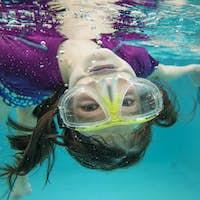 little girl swimming underwater having fun